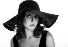 Bella donna in un cappello Immagini Stock Libere da Diritti