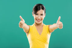 Donna felice con i pollici su Fotografie Stock