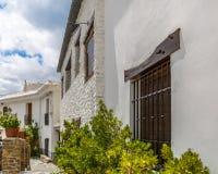 Bella facciata di una casa in La Alpujarra, Granada, Spagna Fotografia Stock