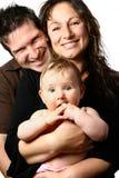 Bella famiglia con i risi soffocati Fotografia Stock