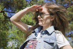 Bella femmina in occhiali da sole Fotografia Stock