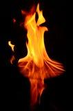 Bella fiamma riflessa nella priorità alta Fotografie Stock