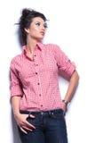 Bella giovane donna che guarda alla sua parte di sinistra Fotografie Stock