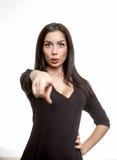 Bella giovane donna che indica il dito voi Immagini Stock Libere da Diritti