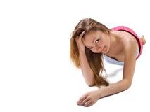 Bella giovane donna che si riposa il pavimento Fotografia Stock