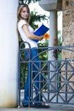Bella giovane donna con i libri ed il fiore Fotografia Stock Libera da Diritti