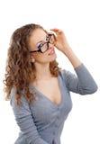 Bella giovane donna con i vetri nel grey immagini stock libere da diritti