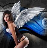 Bella giovane donna con le ali bianche Immagini Stock