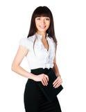 Bella giovane donna con un dispositivo di piegatura Fotografia Stock