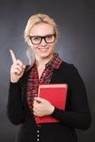 Bella giovane donna con un libro Fotografia Stock