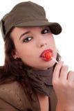 Bella giovane donna con un lollipop Fotografia Stock