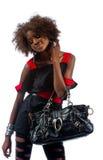 Bella giovane donna di colore con la borsa Fotografie Stock Libere da Diritti
