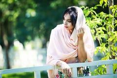 Bella giovane donna in fiori Fotografie Stock