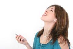 Bella giovane donna ispanica che gode della musica Immagini Stock Libere da Diritti