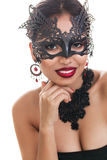 Bella giovane donna nella maschera veneziana di carnevale Fotografia Stock