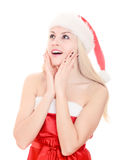 Bella giovane donna sorpresa che porta il cappello della Santa. Fotografia Stock
