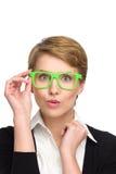 Bella giovane donna sorpresa in vetri verdi. Fotografia Stock Libera da Diritti