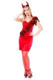 Bella giovane donna in un costume del diavolo Fotografie Stock