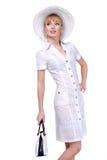 Bella giovane donna in vestiti chiari Fotografia Stock