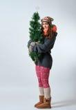 Bella giovane femmina con un albero di Natale Fotografie Stock Libere da Diritti