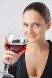 Bella giovane signora con un vetro di vino Fotografia Stock