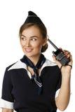 Bella hostess sorridente con la radio dei Cb Fotografia Stock
