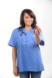 Bella infermiera dei giovani immagini stock