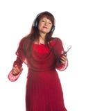 Bella musica d'ascolto della donna adulta Fotografia Stock Libera da Diritti