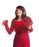 Bella musica d'ascolto della donna adulta Fotografie Stock