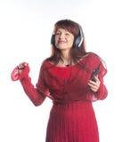 Bella musica d'ascolto della donna adulta Immagini Stock Libere da Diritti