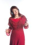 Bella musica d'ascolto della donna adulta Fotografie Stock Libere da Diritti