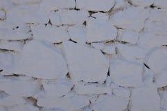 Bella parete di pietra bianca di Mikonos Struttura della priorità bassa Immagine Stock Libera da Diritti