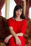 Bella ragazza in abito rosso Fotografia Stock