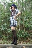 Bella ragazza asiatica che osserva al lato Fotografia Stock