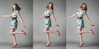 Bella ragazza in attrezzatura alla moda in uno studio. Fotografia Stock