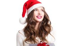 Bella ragazza che indossa i vestiti del Babbo Natale con natale Fotografie Stock