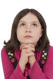 Bella ragazza che prega e che guarda su Immagini Stock