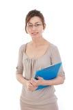 Bella ragazza con capelli marroni con un taccuino in sue mani Fotografia Stock