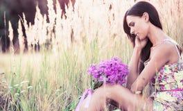Bella ragazza con i fiori Fotografie Stock