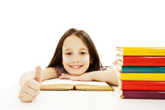 Bella ragazza con i libri di banco sulla tabella Fotografia Stock