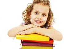 Bella ragazza con i libri di banco sulla tabella Fotografie Stock