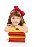 Bella ragazza con i libri di scuola sulla tavola Fotografia Stock Libera da Diritti