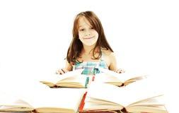 Bella ragazza con i libri sulla tabella Immagine Stock Libera da Diritti