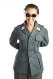 Bella ragazza con i vetri e l'uniforme militare Fotografia Stock
