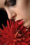 Bella ragazza con il fiore Immagine Stock