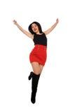 Bella ragazza con il pannello esterno rosso nell'aria Immagine Stock
