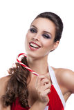 Bella ragazza con la caramella di Natale immagine stock libera da diritti