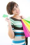 Bella ragazza con la carta di credito ed i sacchetti di acquisto Immagini Stock Libere da Diritti