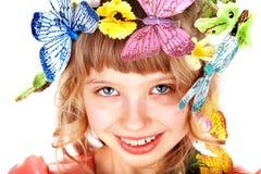 Bella ragazza con la farfalla ed il fiore. Immagini Stock