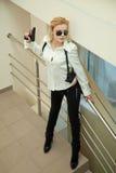 Bella ragazza con la pistola Fotografie Stock